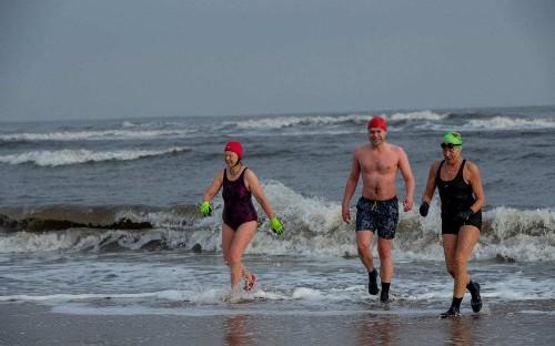 Horrifically cold, yet oddly vivifying: the strange British tradition of the Christmas swim