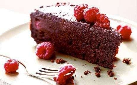 Gooey chocolate cake with raspberries recipe by Bill Granger