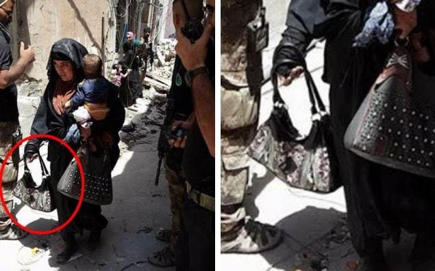 Chilling picture shows female Isil fighter holding child moments before detonating suicide vest