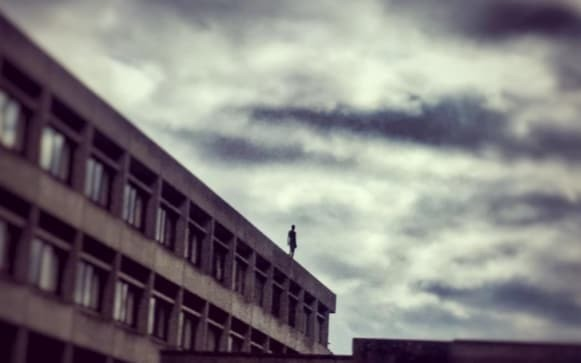 Students speak out against Antony Gormley 'suicide' statue placed on roof of their library