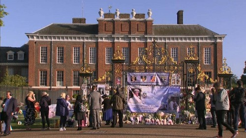 Crowds gather outside Kensington Palace as the nation pays tribute to Princess Diana