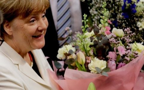 German finally has a government again as Angela Merkel sworn back in as chancellor