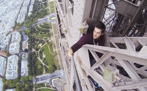 Daredevil climber James Kingston scales the Eiffel Tower with no safety ropes