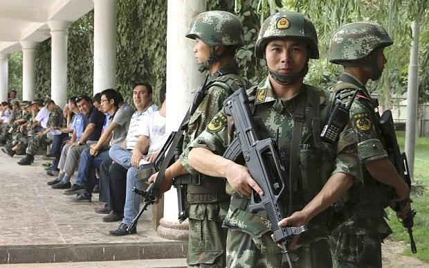 China tells villagers to fight terror by frowning