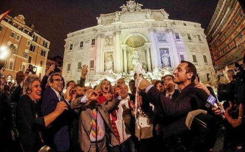 Same-sex unions are not enough, say Italy's exiled gay parents