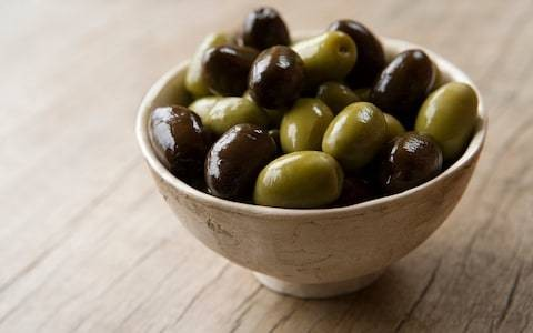 Eating just five olives contains a third of an adult's daily-recommended limit of salt, warn health experts