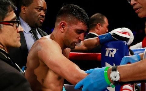 'I can't go out like that': Amir Khan vows to fight on after defeat to Terence Crawford