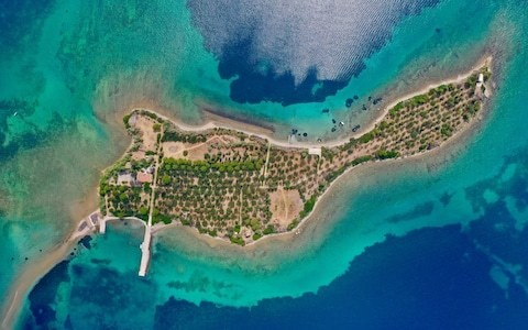 For sale: the guitar-shaped Greek island that The Beatles tried and failed to buy