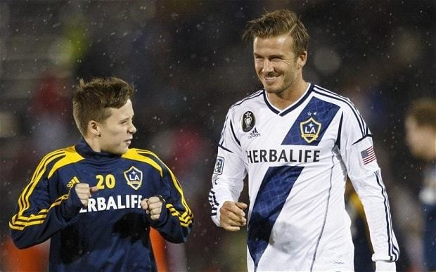 David Beckham's son Brooklyn trains at Manchester United as he bids to follow in father's footsteps