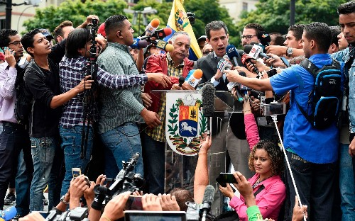 Maduro orders borders closed as tensions mount over aid and rival music concerts