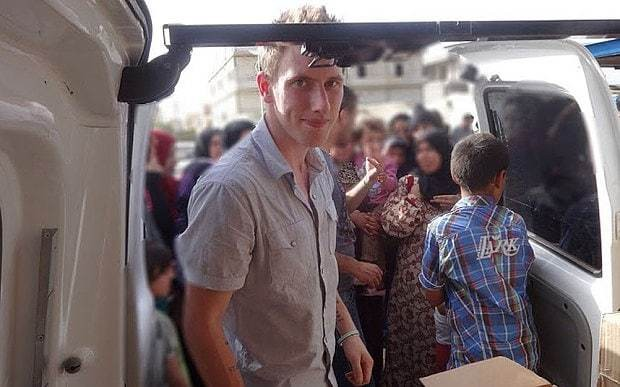 Islamic State threatens US aid worker and former soldier with beheading in new video