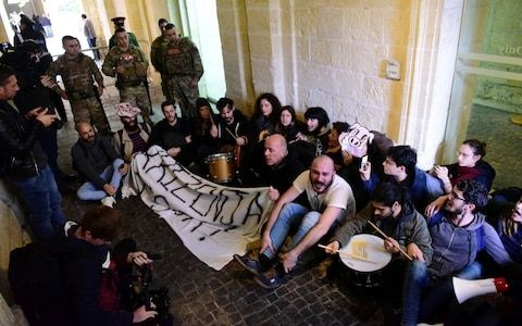 Activists storm office of Malta's prime minister demanding resignation over murder investigation