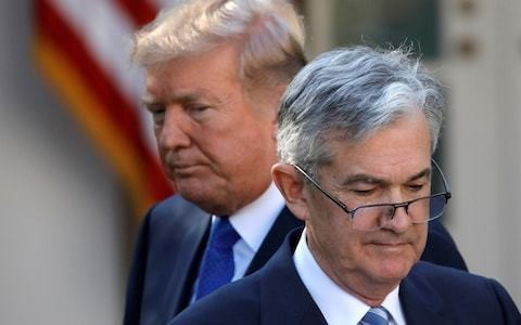 Powell shrugs off Trump's insults to deliver insurance policy for fragile US economy