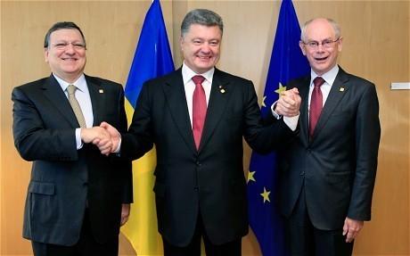 Russia calls Ukraine president a 'Nazi' ahead of historic EU trade deal