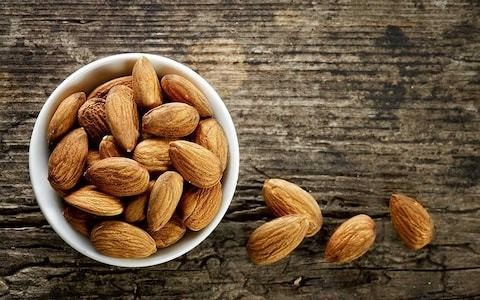 Handful of nuts twice a week can cut chance of dying from heart disease by almost a fifth, study finds