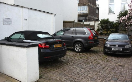 This car park ain't big enough for three of us: Finance boss, doctor and bankers at war over width of parking space