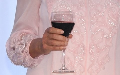 A bottle of wine a week could increase women's cancer risk as much as smoking 10 cigarettes