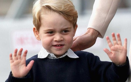 Naughty Prince George caught opening Christmas presents