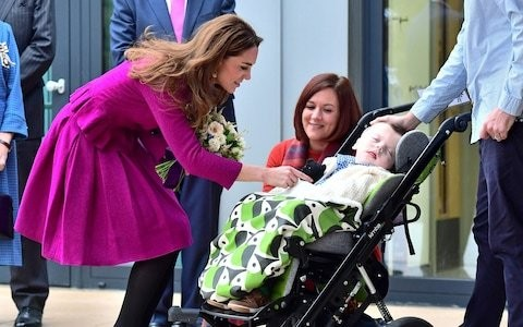 Duchess of Cambridge comforts families at opening of children's hospice