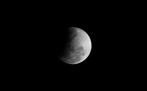 UK enjoys partial lunar eclipse on 50th anniversary of Apollo 11 moon mission launch