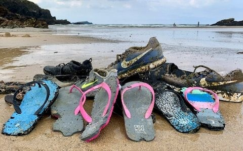 She saw Nike shoes by the sea shore: Hundreds of trainers wash up on beaches after cargo ship lost containers in storm