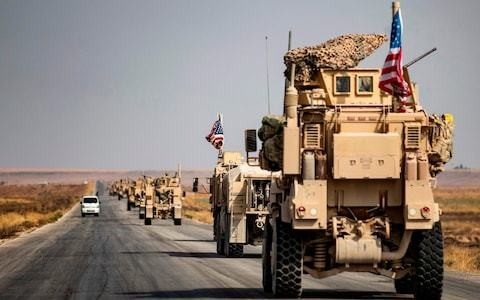 US troops leave northern Syria for Iraq despite Trump's claims they are returning 'home'