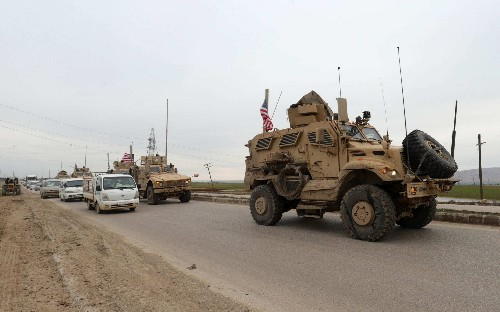 US troops exchange fire with pro-Assad gunmen as Syria and Turkey continue war of words over Idlib standoff