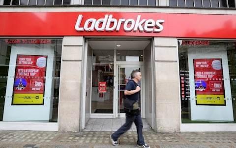 Ladbrokes owner GVC lifts profit guidance despite high street slump