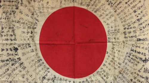 How flags found in attics and junk shops are finally helping put Japanese war dead to rest