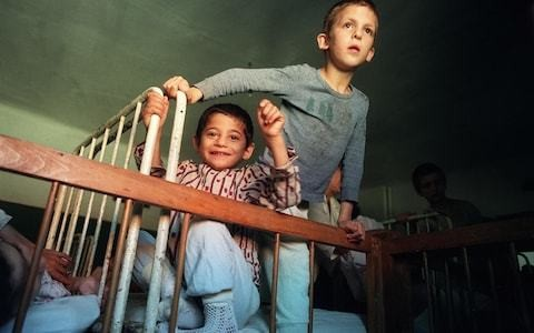 Romanian orphans rescued by British families left with small brains, study finds