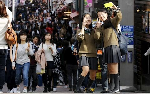 Japanese school pupils told: dye your hair black to fit in