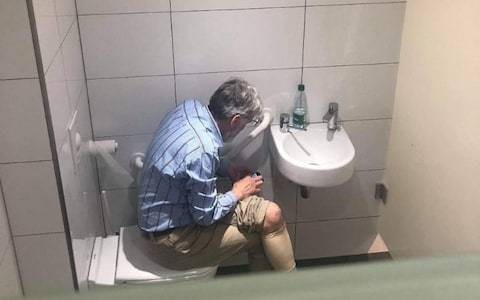 Chess world rocked by scandal after grandmaster pictured using phone on the toilet