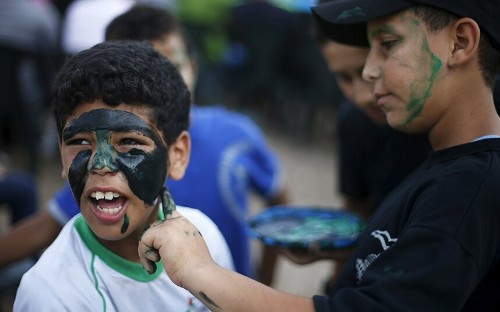 Young Palestinians graduate from Hamas summer camp, in pictures - Telegraph