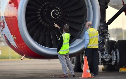 'Bird strike' forces AirAsia flight to divert to Brisbane as passengers describe seeing engine on fire