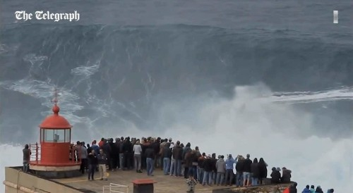 Surfer stuns crowd on huge wave in Portugal