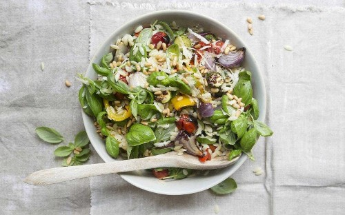 Roasted vegetable and orzo pasta salad with basil, pine nuts and Parmesan