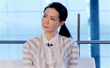 Humanoid robots join staff at Tokyo science museum
