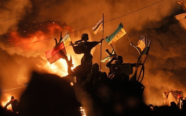 'Golden eagles' storm protester's barricades in Kiev's day of bloodshed