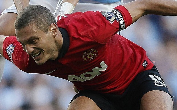 Manchester United captain Nemanja Vidic says loss to Manchester City hurt but backs club to bounce back