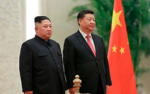 Xi Jinping says he will support Kim Jong-un 'no matter what' in rare front page op-ed ahead of visit