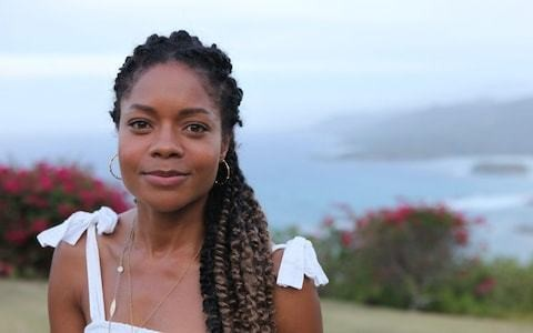 Naomie Harris has lived down the road from her estranged father's family for years, Bond girl discovers