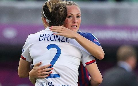 Lucy Bronze comforts England teammate Toni Duggan after Barcelona's Champions League thrashing by Lyon