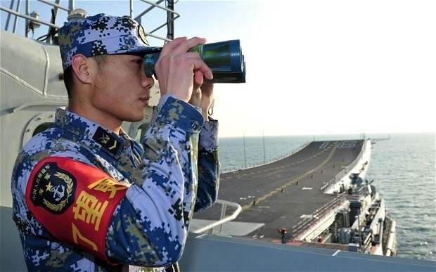 US and Chinese warships narrowly avoid collision in South China Sea