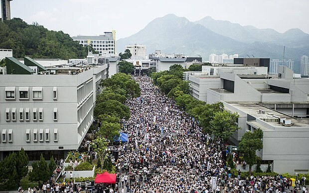 Hong Kong school children join student protest demanding democracy