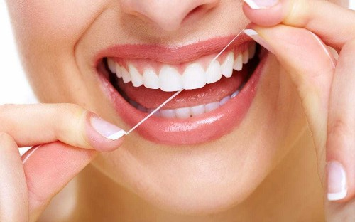 Flossing teeth does little good, investigation finds as US removes recommendation from health advice