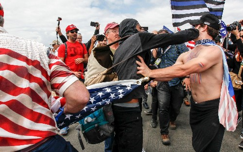 Pro-Donald Trump rally erupts in violence as protesters use pepper spray against organisers
