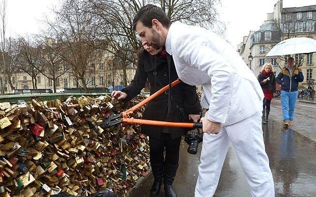 Parisians ease burden of love with bolt-cutters