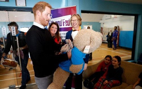 Prince Harry dishes up a hot lunch for children as he warns closure of 'vital' youth clubs leave them socially isolated