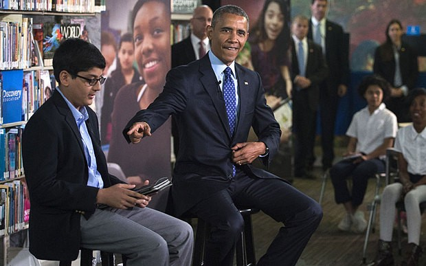 Awkward moment a schoolboy cuts off President Barack Obama for talking too much