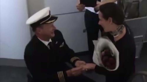 Romantic pilot stuns girlfriend with marriage proposal during flight
